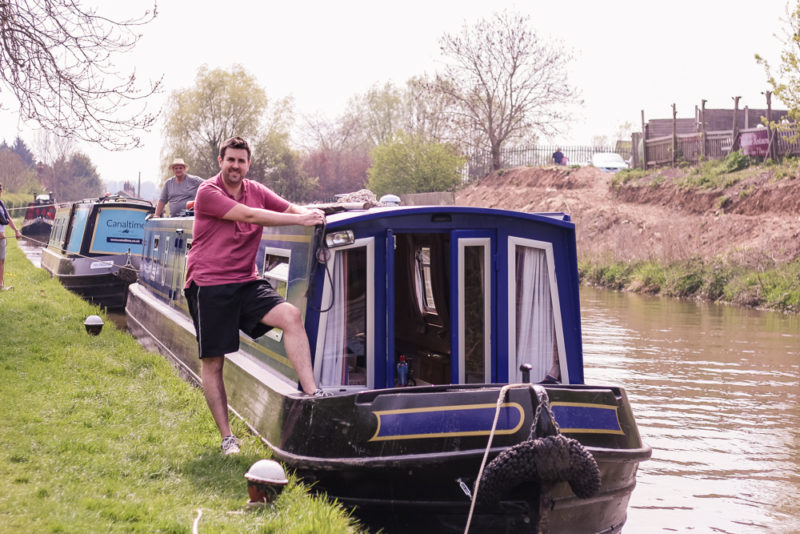 Jim standing at the front of the canal boat, mooring up