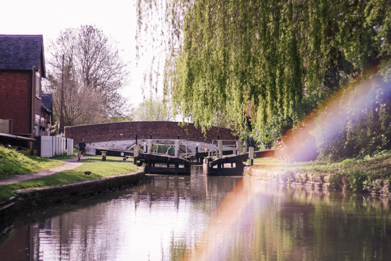 A rainbow lens flare on a photo of a canal lock on the Grand Union Canal