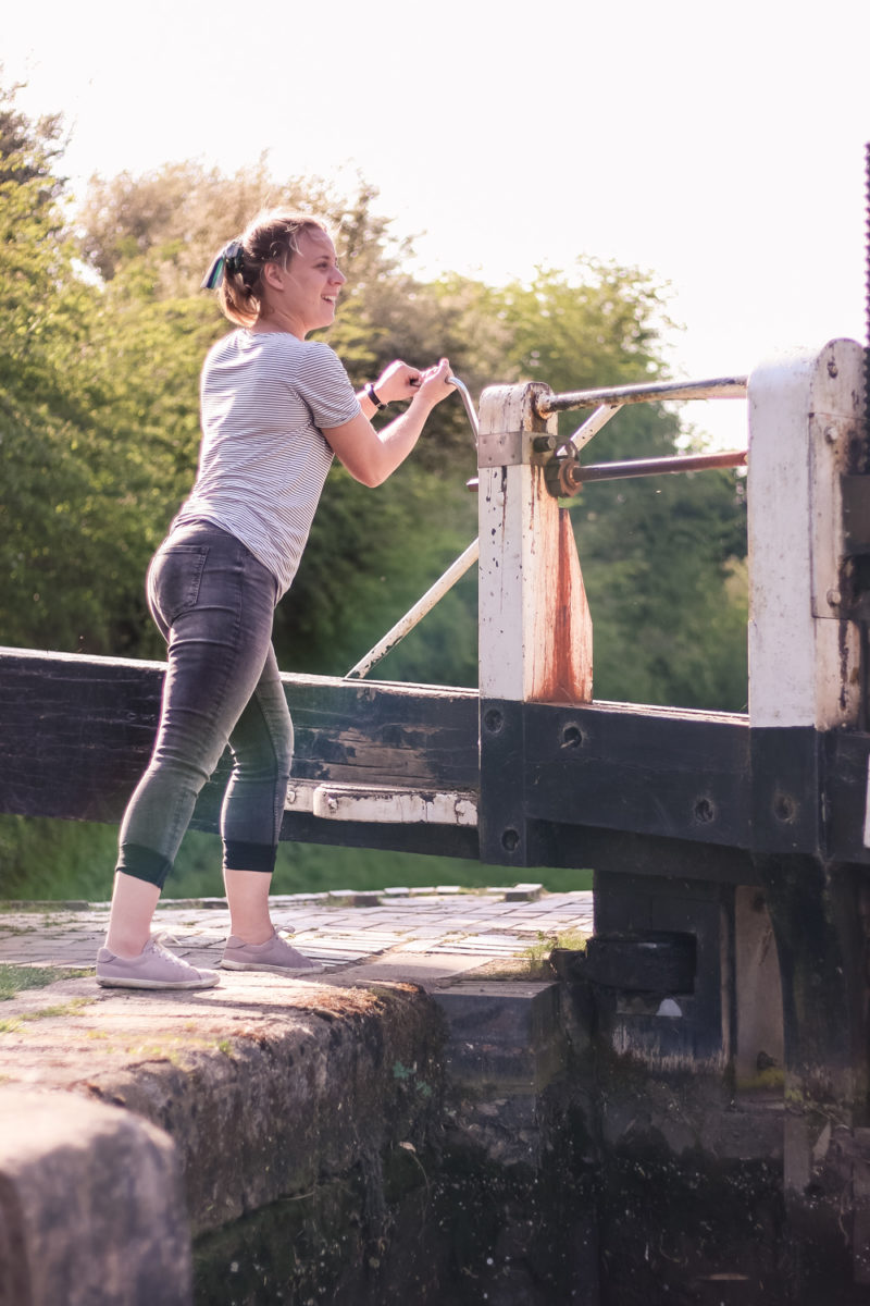 Holly opening the paddles on a lock on the Grand Union Canal