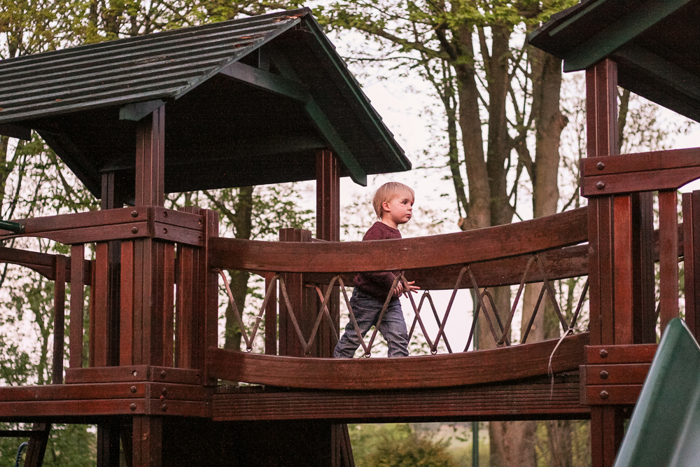 Pickle crossing a bridge in the playground closest to our tent pitch at Golden Valley campsite