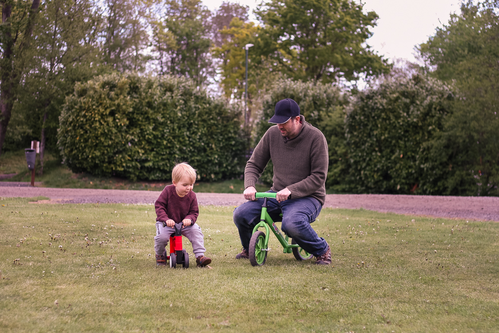 Jim and Pickle playing on their bikes outside the tent.