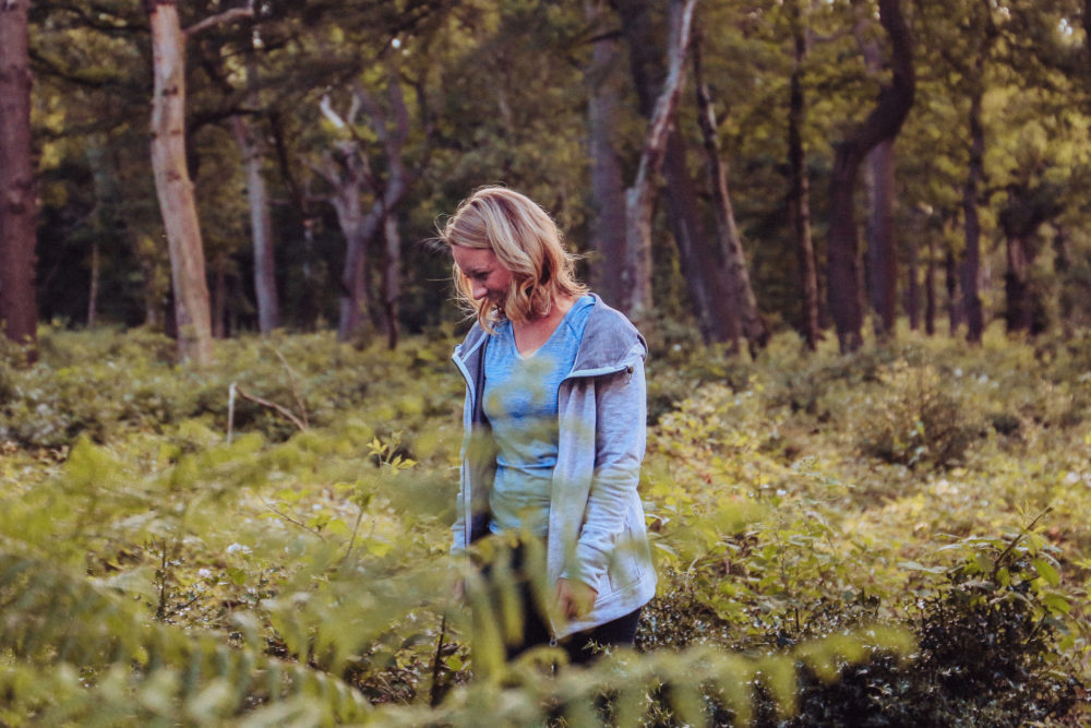 Holly standing in the woods at Sutton Park, photo by Amy Eliza Photography