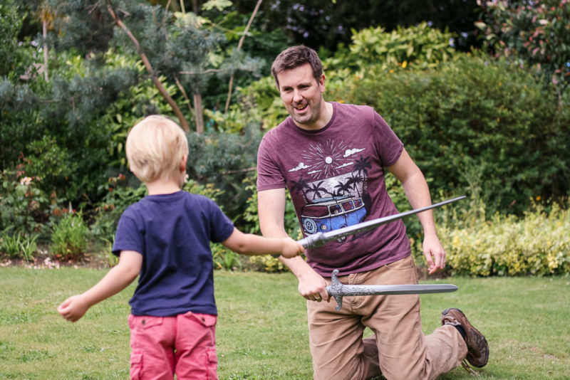 Pickle and Daddy playing sword fighting