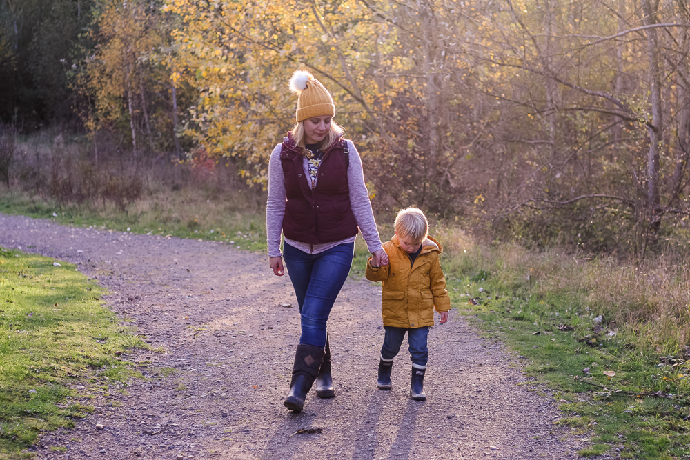 Enjoying a family day out at Conkers - Holly and Pickle walking towards the camera