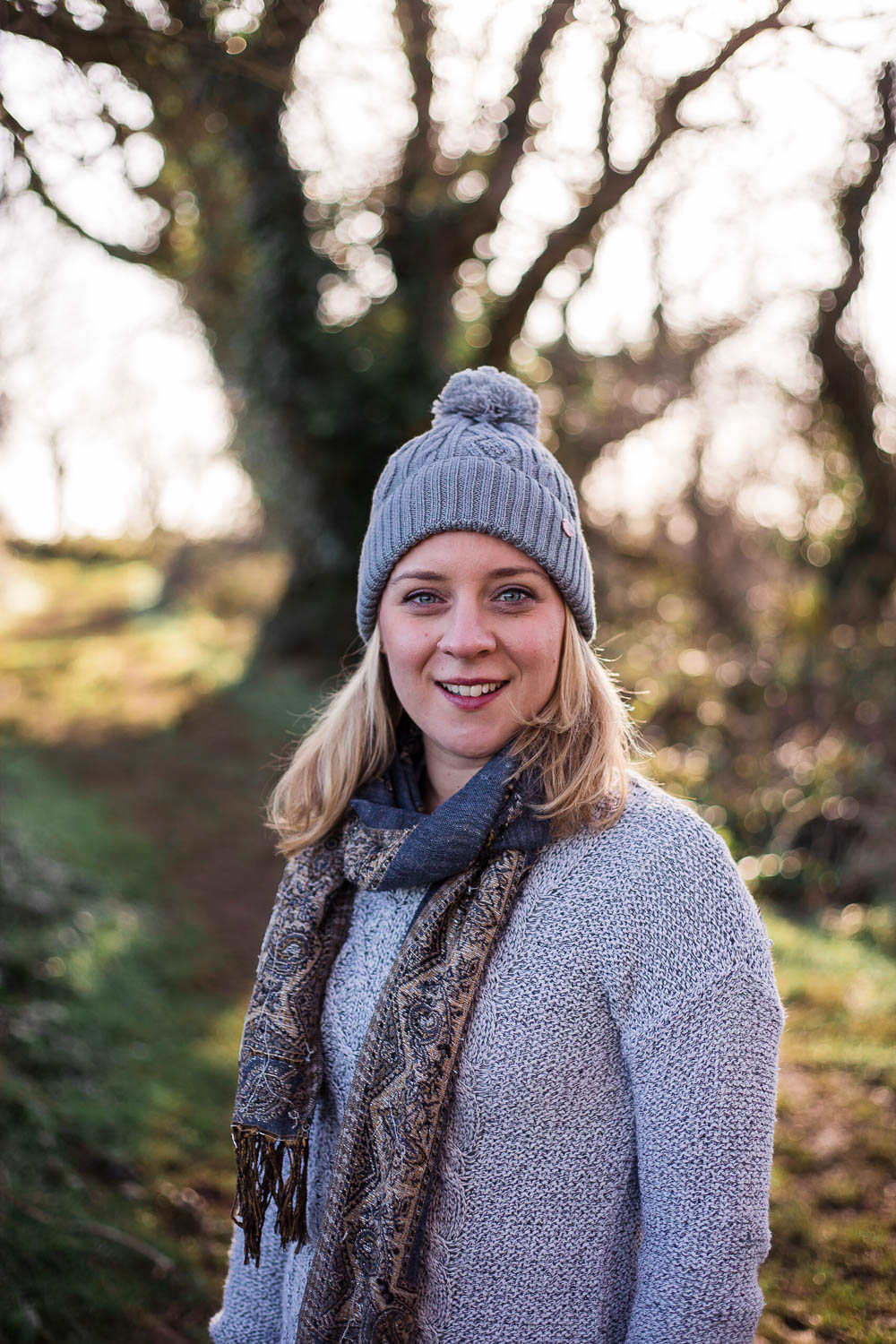 Holly outside wearing a grey Merino Wool Beanie Hat from ACAI Activewear