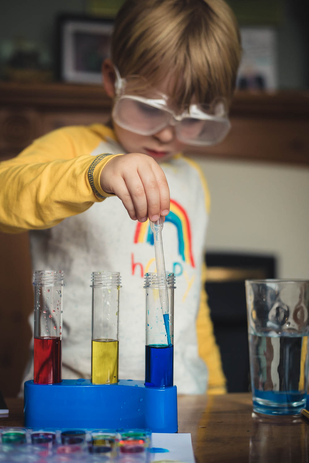 Pickle concentrating on mixing colours in a Rainbow Lab Kit experiment