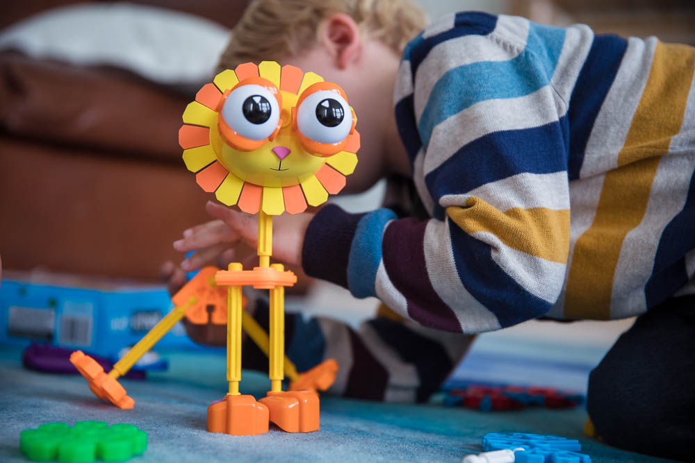Pickle adding parts on to the lion in the Safari Mates Kids K'Nex set