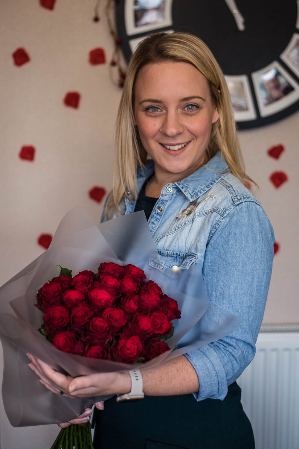 Holly holding a bunch of 24 red roses delivered from Moonpig