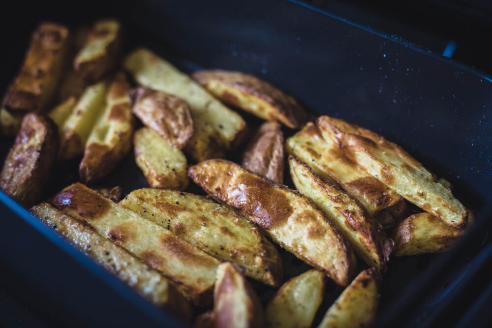 Homemade chips in the crisping basket of the Ninja Foodi MAX
